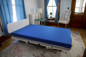 Floor hugger with vinyl mattress cover