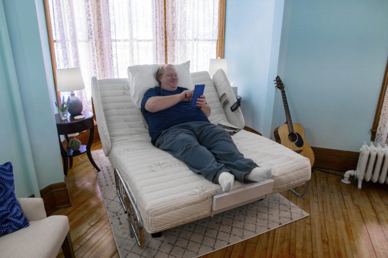 Heavy Duty bariatric hospital bed in full size with user in bed